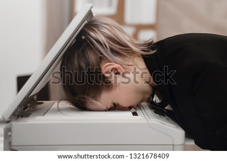 Businesswoman sleeping on printer at office. Overworked concept. #1321678409