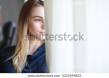 A young girl in a home setting is resting in a big apartment #1321694825