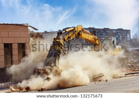 Bulldozer crushing the building at construction site Royalty-Free Stock Photo #132175673