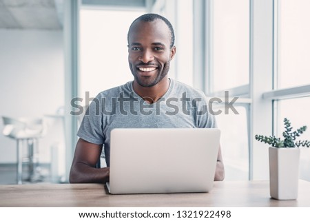 Young businessman working on his laptop in office. #1321922498