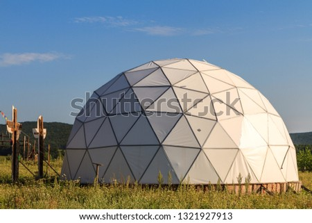 white geodesic dome on sunny summer day #1321927913