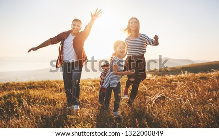 Happy family: mother, father, children son and daughter on sunset #1322000849