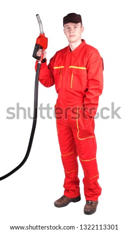 Man gas station staff  is holding red gasoline pistol pump fuel nozzle #1322113301