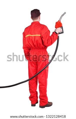 Man gas station staff  is holding red gasoline pistol pump fuel nozzle rear view from back  #1322128418