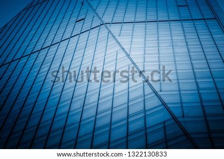 Urban abstract - windowed corner of office building #1322130833