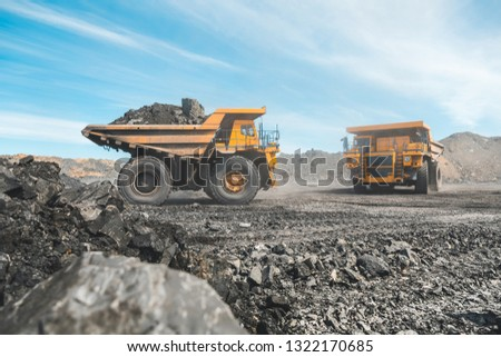Large quarry dump truck. Loading the rock in dumper. Loading coal into body truck. Production useful minerals. Mining truck mining machinery, to transport coal from open-pit as the Coal Production #1322170685