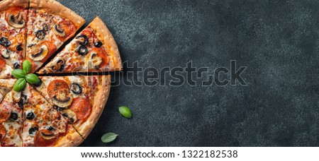 Tasty pepperoni pizza with mushrooms and olives. Top view with copy space. Banner. #1322182538