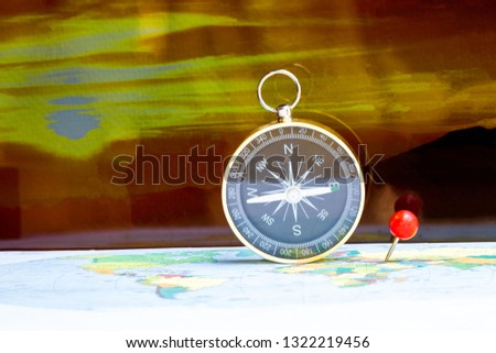 Magnetic compass on a world map conceptual of global travel #1322219456