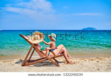 Two year old toddler boy on beach with mother. Summer family vacation. Sithonia, Greece.  #1322240234