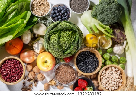 Background of healthy food and clean eating with fruit, vegetable, superfood, leaf vegetable. Soft focus. #1322289182