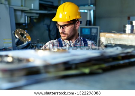 Factory engineer checks the quality of the manufactured part #1322296088