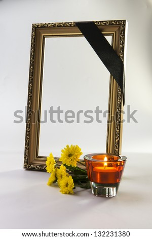gold frame with sympathy ornament