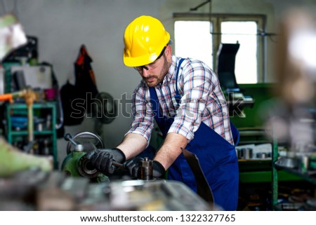 The milling-machine operator works at the lathe. #1322327765