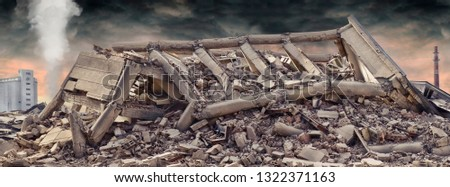 Collapsed concrete industrial building isolated on white background with dramatic sky and factory chimney and another concrete building in background. Disaster scene full of debris, dust and damaged #1322371163