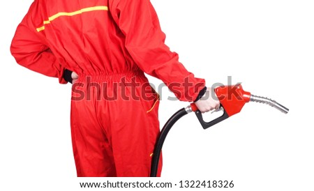 Man gas station staff  is holding red gasoline pistol pump fuel nozzle rear view from back                                 #1322418326