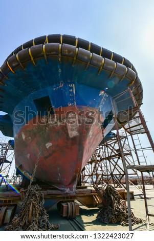 Shipyard wharf maintenance equipment and various vessels under maintenance  #1322423027