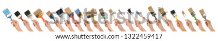 Set of women holding different clean paint brushes on white background, closeup #1322459417
