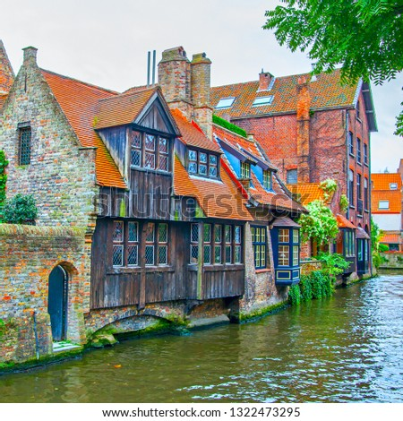 Medieval houses by canal in Bruges (Brugge), Belgium #1322473295