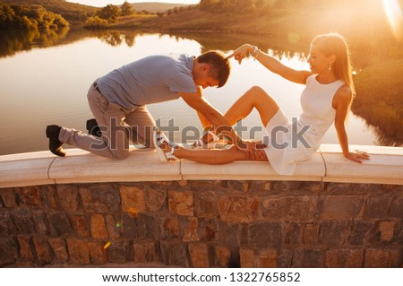 role-playing games of a couple in love at sunset on the bridge #1322765852
