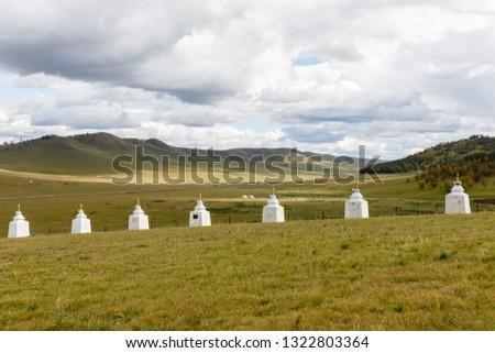 Buddhist monastery in the steppes, Stupas along the wall of a Mongolian monastery, Bornuur Mongolia #1322803364