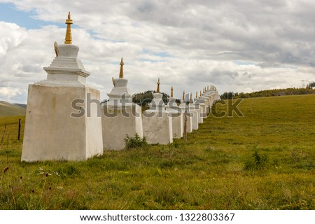 Buddhist monastery in the steppes of Mongolia, Stupas along the wall of a Mongolian monastery, Bornuur #1322803367