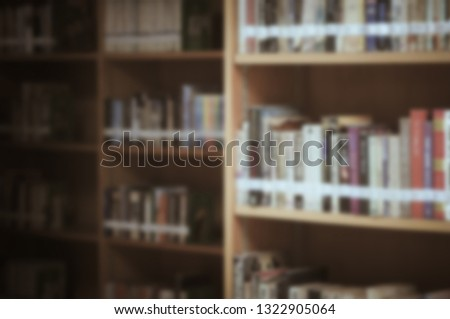 Stack of books in the library and blur bookshelf background #1322905064