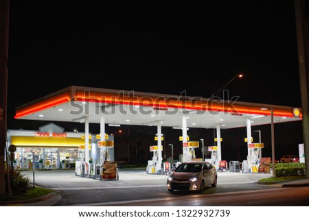 MIAMI - FEBRUARY 24, 2019: Car exiting a gas station at night #1322932739