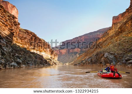 Group of friends rafting down a river. #1322934215