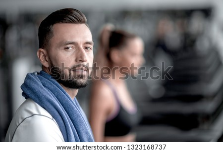 close up. modern attractive man in the gym. #1323168737