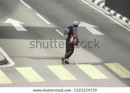 Kuala Lumpur, Malaysia - January 2019 : Pedestrian in the city.  Busy city, Busy people walking by. #1323224729