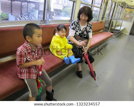 Asian grandmother and little kids in the train #1323234557