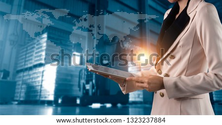 Businessman manager using laptop check orders online goods worldwide for network with Modern Trade warehouse logistics. Industry of logistics network concept. #1323237884