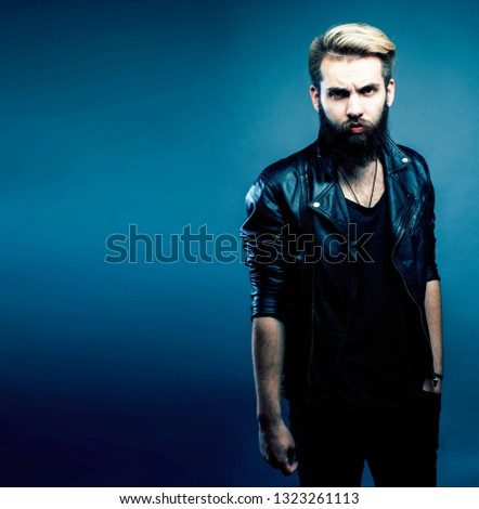 portrait of young bearded hipster guy smiling on gray background close up, lifestyle people concept copyspace #1323261113