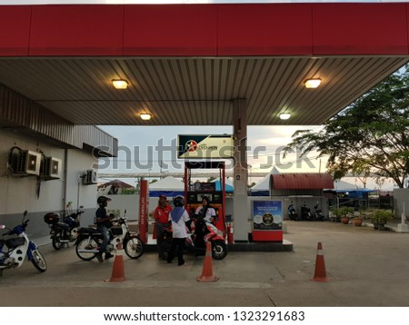 Pasir Mas, Kelantan. November 19, 2018. Motorcyclists queuing at Caltex petrol station at Pasir Mas town. The government follows a method called the managed float system with respect to fuel prices. #1323291683