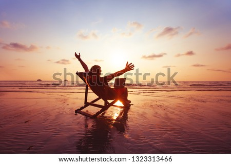 happy freelancer with laptop computer working on the beach, freelance work concept, dream office job workplace Royalty-Free Stock Photo #1323313466