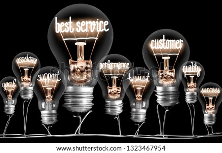 Photo of light bulb group with shining fibers in a shape of BEST SERVICE concept related words isolated on black background #1323467954