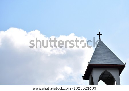 Church Roof with a cross. Church building roof with holy cross. Cloudy moody sky background.