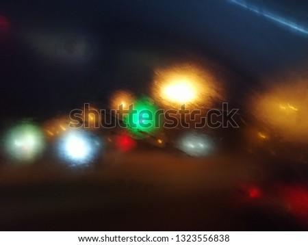 Blurred light effects. Neon glow. Night traffic.  Abstract background. Colorful pattern. #1323556838