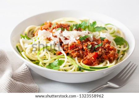 keto paleo zoodles bolognese: zucchini noodles with meat sauce and parmesan #1323558962