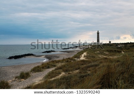 The lighthouse Grenen (called Grey Tower) near Skagen (Denmark, North Jutland) at the junction of Skagerrak (North Sea) and Kattegat (Baltic Sea) #1323590240