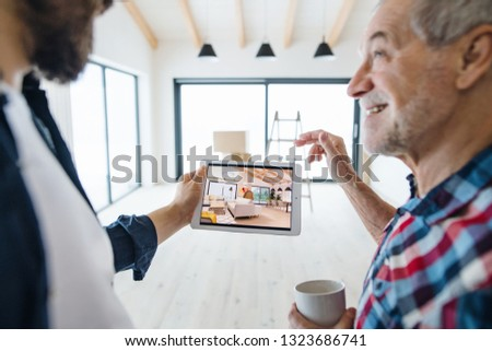 A senior man helping his son with furnishing new house, a new home concept. #1323686741