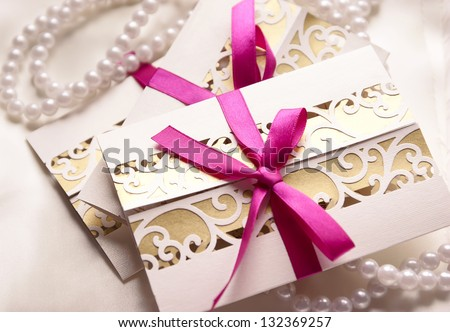 Handmade wedding invitations with fuchsia ribbon