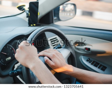 Closeup Driver's hand pressing on a car horn while driving #1323705641