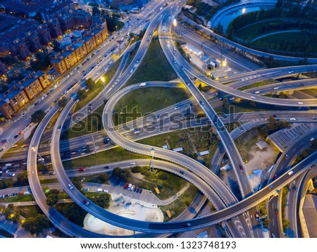 Night view from drone of lighted overpass interchange in modern town #1323748193