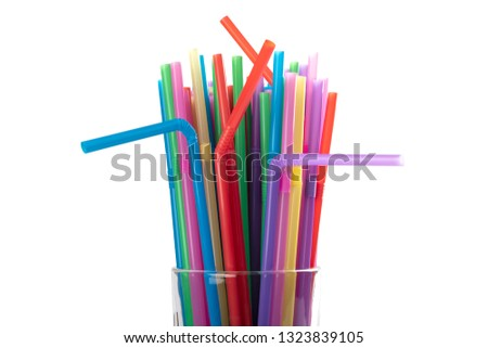 Many colorful tubes in cocktail glass isolated on white background. The concept of the party #1323839105