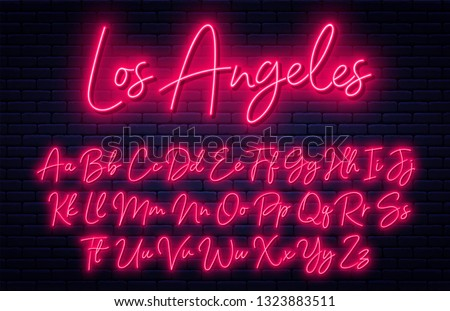 Glowing neon script alphabet. Neon font with uppercase and lowercase letters. Handwritten english alphabet with neon light effect Royalty-Free Stock Photo #1323883511