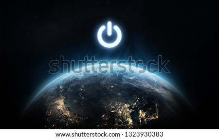 Planet Earth and power button. Earth hour event. Ecology. Elements of this image furnished by NASA #1323930383