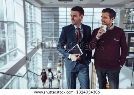 Two handsome businessmen socializing in front of office #1324034306