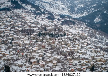Aerial view of the snowy Metsovo is a town in Epirus, in the mountains of Pindus in northern Greece and attracts many visitors #1324037132