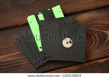 Floppy disks and disks on wooden background #1324138859
